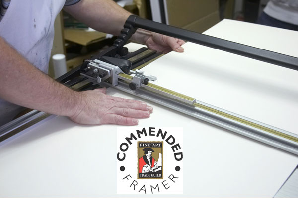Mount cutting with Guild Commended Framers Logo